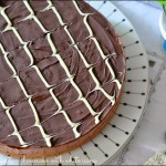 Chocolate digestive cheesecake with white icing