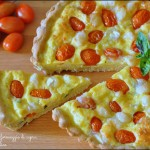 Torta salata con pomodorini, basilico e formaggio di capra